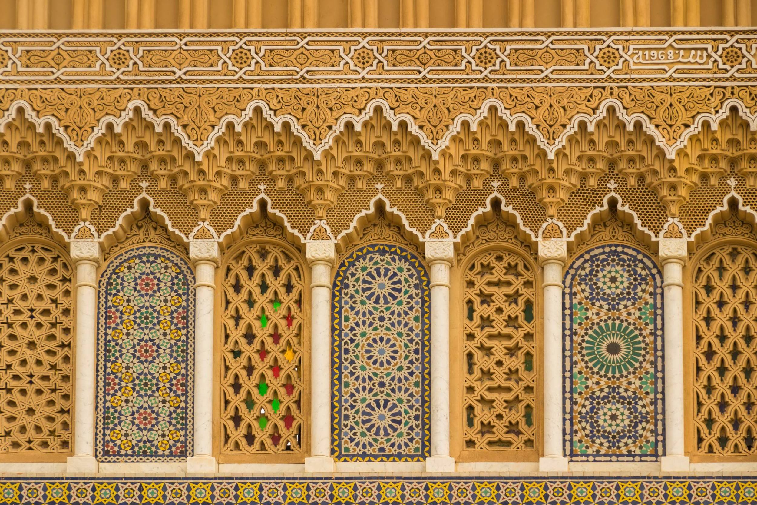 Canva - Islamic calligraphy and colorful geometric patterns a Morocco.