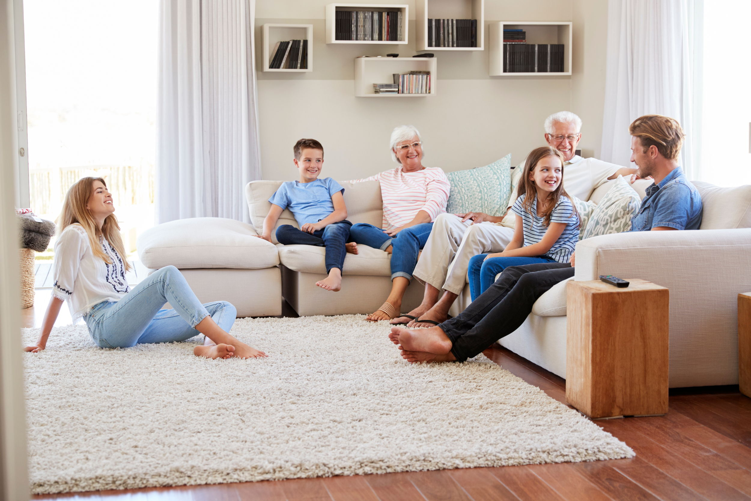 Canva - Family Relaxing on Sofa at Home