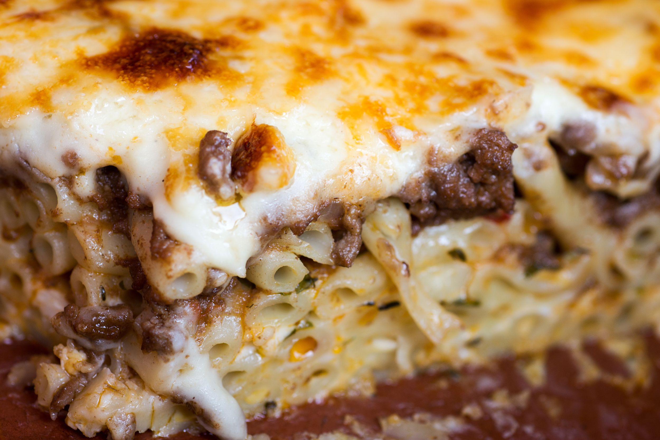 Canva - Pastitsio Traditional Greek Baked Pasta Casserole With Ground Beef, Tomatoes, Feta Cheese and Bechamel Sauce